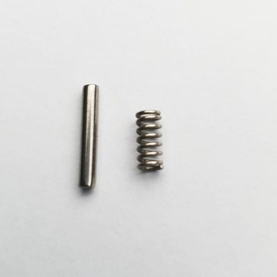 bolt and magazine release pin spring